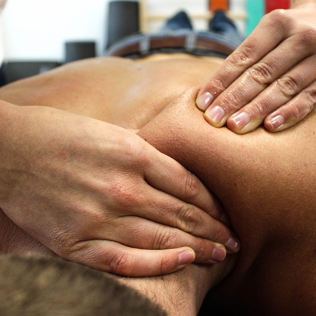 Man recieving a Therapeutic Deep Tissue Massage